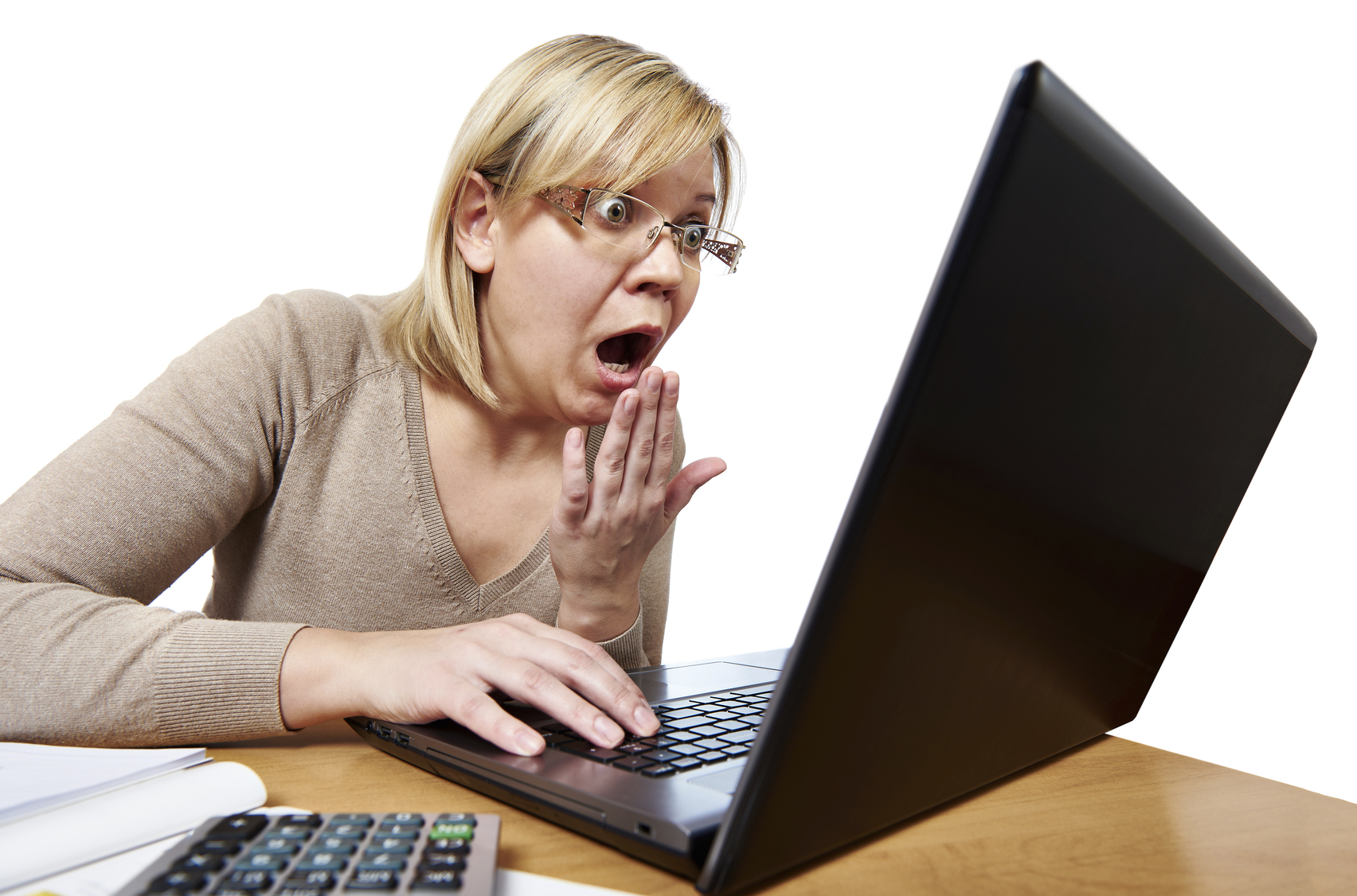 Frightened woman with glasses looking at laptop isolated